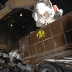 One-ton waste sample coming off of a dump truck before being sorted at recycling services company B-P Trucking, Inc. in Ashland, MA