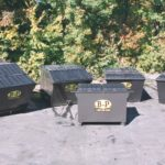A set of three rear load containers by B-P Trucking Inc