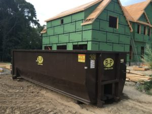 A Photo Of A Dumpster In Use Requisitioned From A Rental Company In Ashland, MA - B-P Trucking Inc